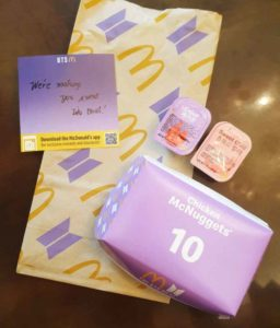 McDonalds BTS Meal in the Philippines with a note that says we're making you sweat like that